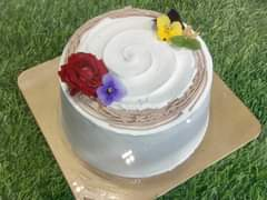 May be an image of cake and flower
