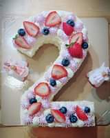 May be an image of strawberry and cake